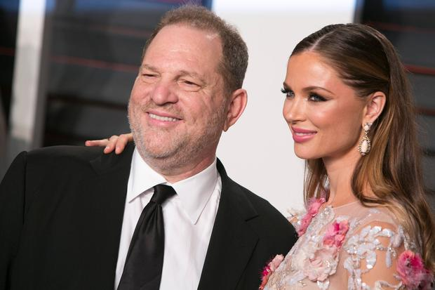 US producer Harvey Weinstein poses with his wife Georgina Chapman as they arrive to the 2016 Vanity Fair Oscar Party in Beverly Hills, California on February 28, 2016. / AFP / ADRIAN SANCHEZ-GONZALEZ