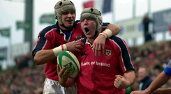 Alan Quinlan congratulates Anthony Foley during their European Cup victory over Castres back in 2001. Photo: Sportsfile