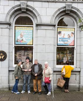 Customers Charles and Theresa Heaney, and Donal and Mary Deady, outside the branch. Photo: Liam Burke/Press 22