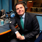 Finance Minister Paschal Donohoe with presenter Sean O'Rourke during a phone-in show on the Budget on RTÉ Radio 1. Photo: Steve Humphreys