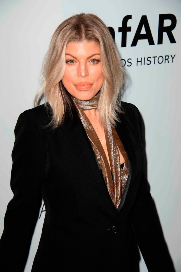 Singer Fergie attends the amfAR Gala Los Angeles honoring actress Julia Roberts on October 13, 2017 in Beverly Hills, California. / AFP PHOTO / VALERIE MACONVALERIE MACON/AFP/Getty Images