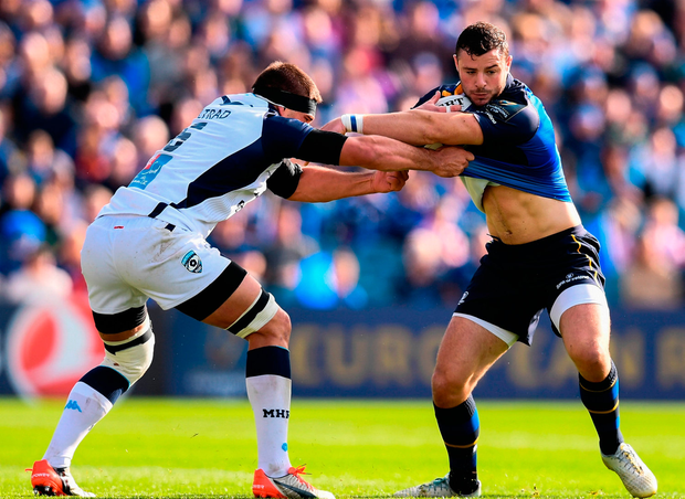 Robbie Henshaw of Leinster is tackled by Kelian Galletier of Montpellier