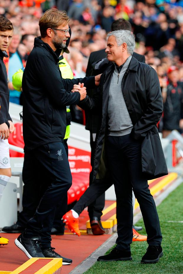 Liverpool boss Jurgen Klopp with Jose Mourinho