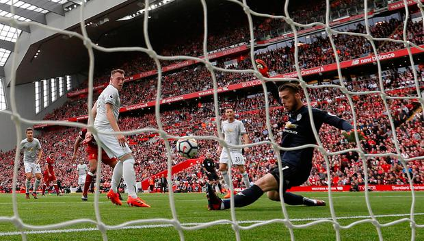 Manchester United's Phil Jones watches as David De Gea makes a brilliant save
