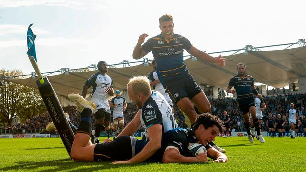14 October 2017; Joey Carbery of Leinster goes over to score his side's first try despite the tackle of Jesse Mogg of Montpellier during the European Rugby Champions Cup Pool 3 Round 1 match between Leinster and Montpellier at the RDS Arena in Dublin. Photo by Stephen McCarthy/Sportsfile
