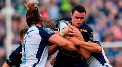 James Ryan of Leinster is tackled by Jacques Du Plessis, left, and Kelian Galletier of Montpellier during the European Rugby Champions Cup Pool 3 Round 1 match between Leinster and Montpellier at the RDS Arena in Dublin. Photo by Ramsey Cardy/Sportsfile