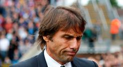 Chelsea manager Antonio Conte looks dejected after the match. REUTERS/David Klein