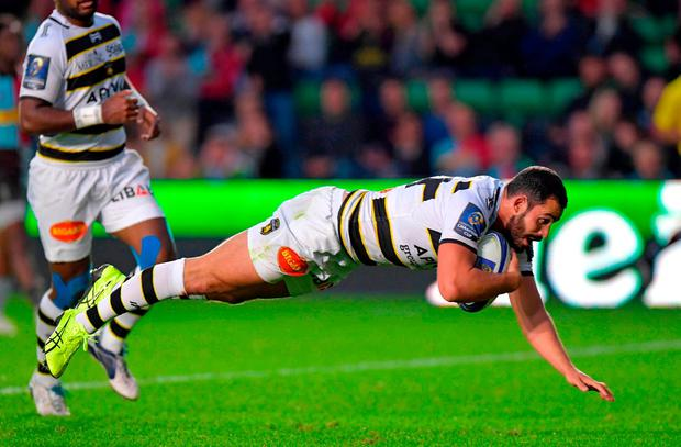 La Rochelle's French centre Geoffrey Doumayrou dives over the line to score a try