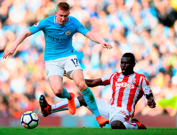 Kevin De Bruyne rides the tackle of Mame Biram Diouf during Manchester City's 7-2 rout of Stoke City at the Etihad Stadium yesterday. Photo: Getty Images