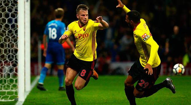 Tom Cleverley of Watford (8) celebrates as he scores their second goal with Etienne Capoue. Photo: Getty Images