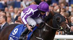 US Navy Flag ridden by Ryan Moore leads the field home to win The Darley Dewhurst Stakes at Newmarket and give Aidan O'Brien his 24th winner of the calendar year. Photo: PA