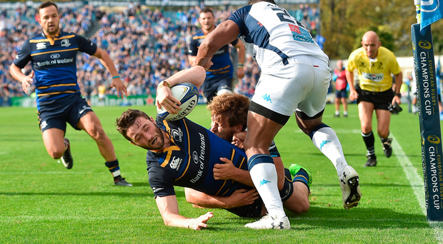 Barry Daly scores Leinster's fourth try despite being tackled by two Montpellier players during yesterday's European Rugby Champions Cup game at the RDS Arena. Photo: Matt Browne