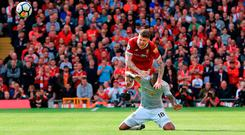 Liverpool's Alberto Moreno goes over the top of Manchester United's Ashley Young during yesterday's Premier League match at Anfield. Photo: PA Wire