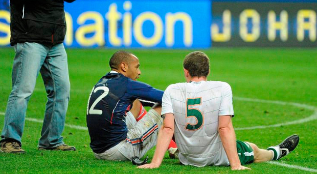 Thierry Henry sits with Richard Dunne after his handball helped France to a play-off win in 2009. Photo: Sportsfile