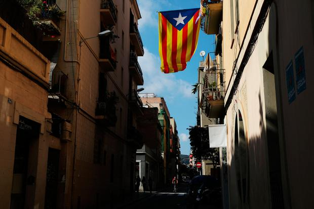 A Catalan separatist flag hangs from a balcony in Barcelona, Spain October 11, 2017. REUTERS/Susana Vera