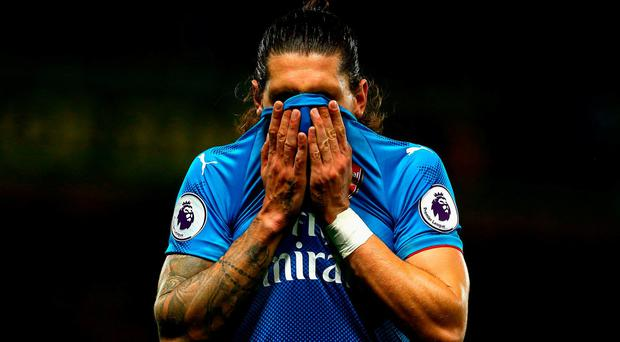 Hector Bellerin of Arsenal reacts during the Premier League match between Watford and Arsenal at Vicarage Road