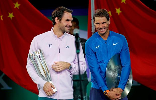 Winner Roger Federer of Switzerland and Rafael Nadal of Spain after the final of the Shanghai Masters