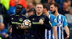 Everton's Wayne Rooney runs back to the centre spot with the ball after scoring their equaliser