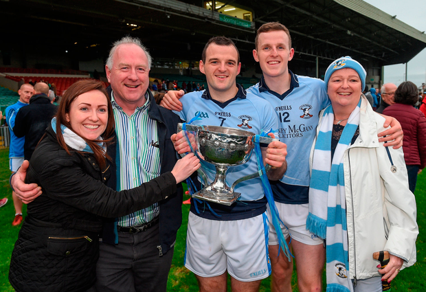 Brothers Alan Dempsey and David Dempsey of Na Piarsaigh celebrate with their sister Jennifer, father Ger, and mother Jean