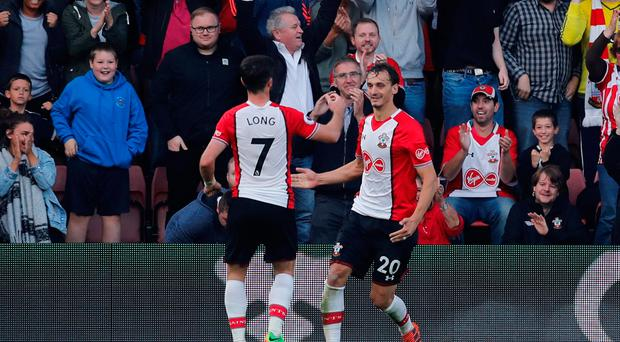 Southampton's Manolo Gabbiadini celebrates scoring their second goal with Shane Long