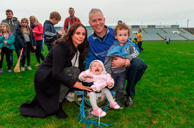 Na Piarsaigh manager Shane O'Neill celebrates with his wife Michelle, daughter Sáerlaith, aged 9 months, and son Caolan, aged 2-and-a-half