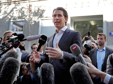 Sebastian Kurz, head of Austrian People's Party, talks to the media after casting his vote in Vienna, Austria