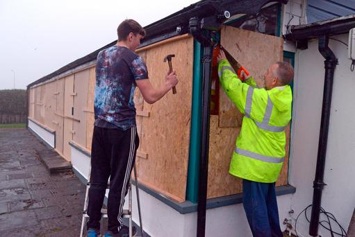 Pictured getting ready for hurricane Ophelia at Courtmacsherry Bay West Cork was Martin Galvin and his son Adam. Their seaside home at Lobster Cottage sits in Courtmacsherry Bay with County Cork expected to be among the worst effected counties. Picture Denis Boyle