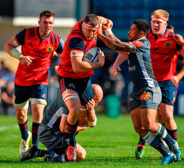 Munster's Robin Copeland is tackled by Mihaita Lazar and David Smith of Castres. Photo: Brendan Moran/Sportsfile