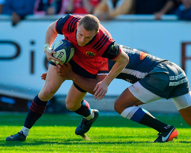 Munster's Keith Earls is tackled by Afusipa Taumoepeau of Castres. Photo: Brendan Moran/Sportsfile