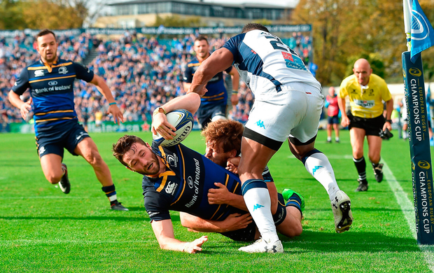 Leinster's Barry Daly scores his side's fourth try despite the tackle by Montpellier players Nemani Nadolo, behind, and Timoci Nagusan. Photo: Matt Browne/Sportsfile