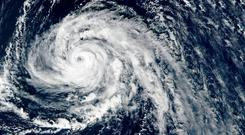 Hurricane Ophelia strengthened to a Category 3 storm as it passed near the Portuguese Azores archipelago on October 14 on route for Ireland. Photo: Getty Images