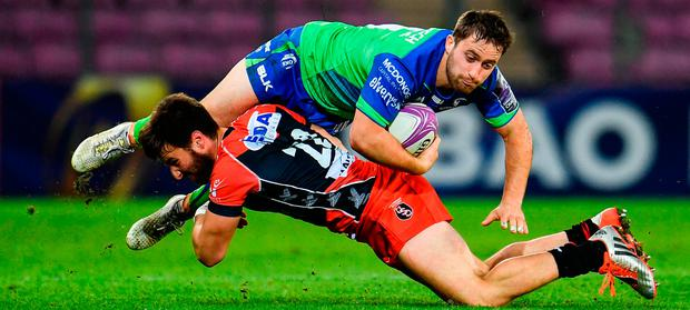 Connacht's Caolin Blade is tackled by Jérémy Scalese at Stade de Geneve. Photo: Sam Barnes/Sportsfile