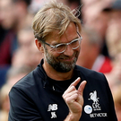 Liverpool manager Jurgen Klopp is smiling again after Saturday's win against Huddersfield. Photo: Reuters