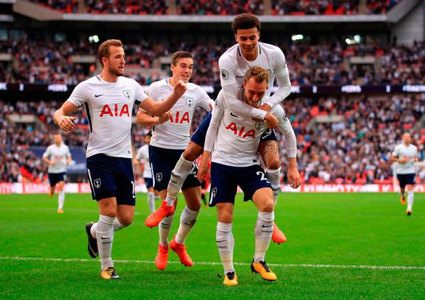 Tottenham Hotspur's Christian Eriksen celebrates scoring against Bournemouth with his team-mates at Wembley. Photo: PA Wire