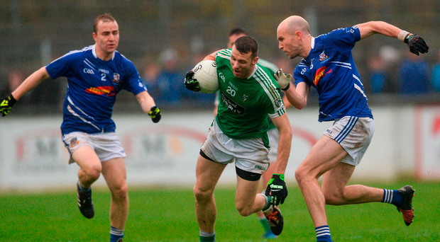 Moorefield's Ronan Sweeney tries to get past the Celbridge pair of Michael Konstantin, left, and Hugh McGrillen during yesterday's county final, in which Sweeney won a record eighth Kildare SFC medal. Photo: Piaras Ó Mídheach/Sportsfile