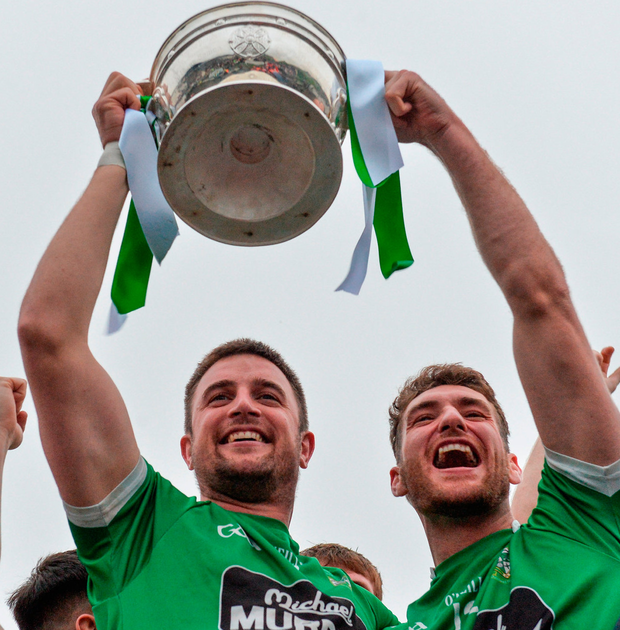 Moorefield captain Daryl Flynn (left) lifts the Dermot Bourke Cup with his team-mate David Whyte. Photo: Piaras Ó Mídheach/Sportsfile