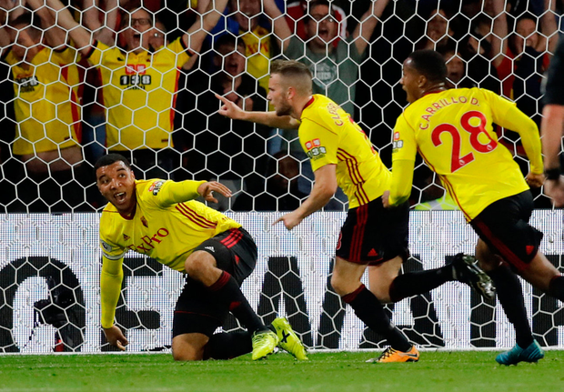 Watford's Troy Deeney (l) celebrates with Tom Cleverly (c) after he scored the winner against Arsenal on Saturday. Photo: Reuters