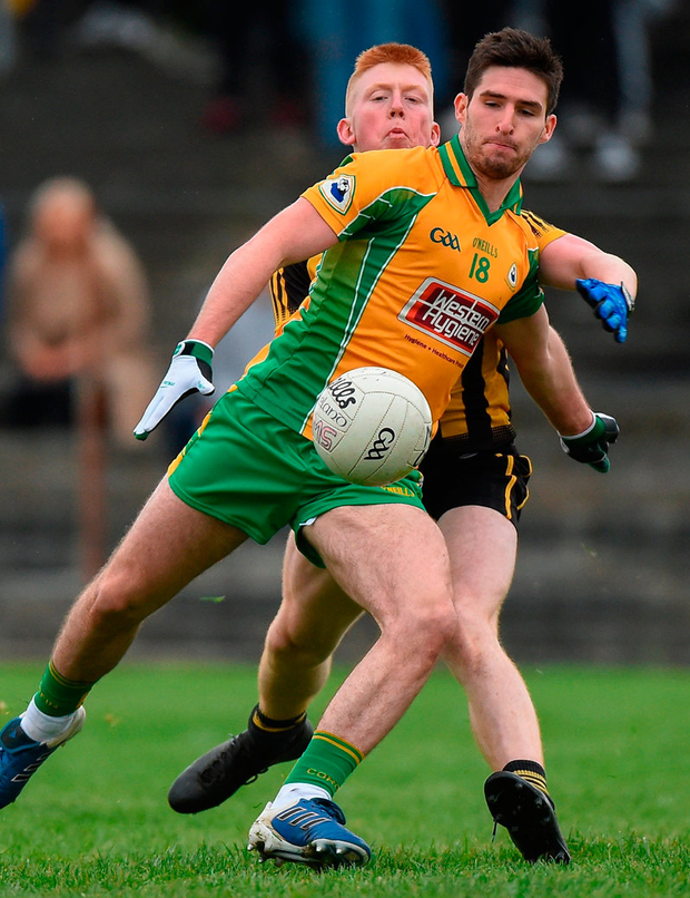 Corofin's Martin Farragher in action against Shane Moran of Mountbellew/Moylough. Photo: Matt Browne/Sportsfile