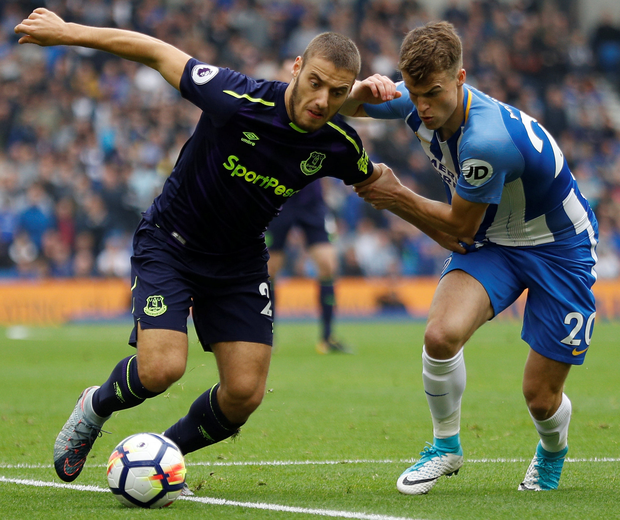 Everton's Nikola Vlasic keeps possession from Brighton's Solly March. Photo: Reuters.