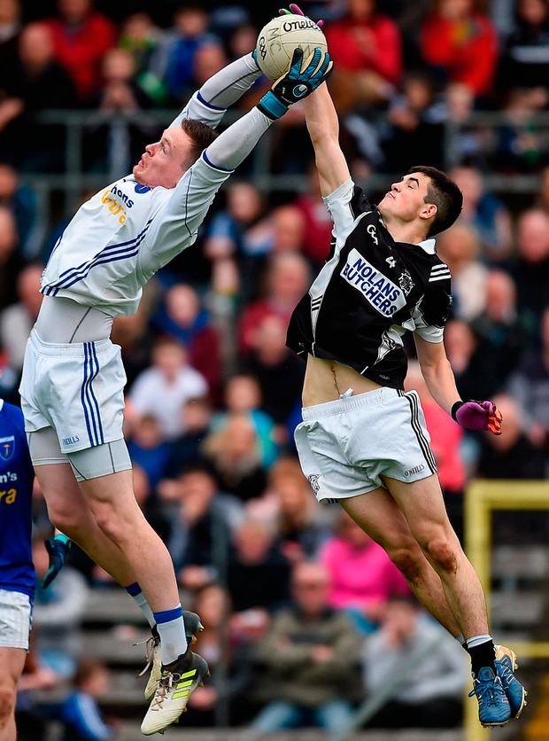 Rory Beggan of Scotstown and Magheracloone's Paudie McMahon challenge for the ball during the Monaghan SFC final. Photo: Philip Fitzpatrick/Sportsfile