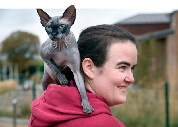 Aimee Henderson with her Sphynx, Donald. Photo: INM