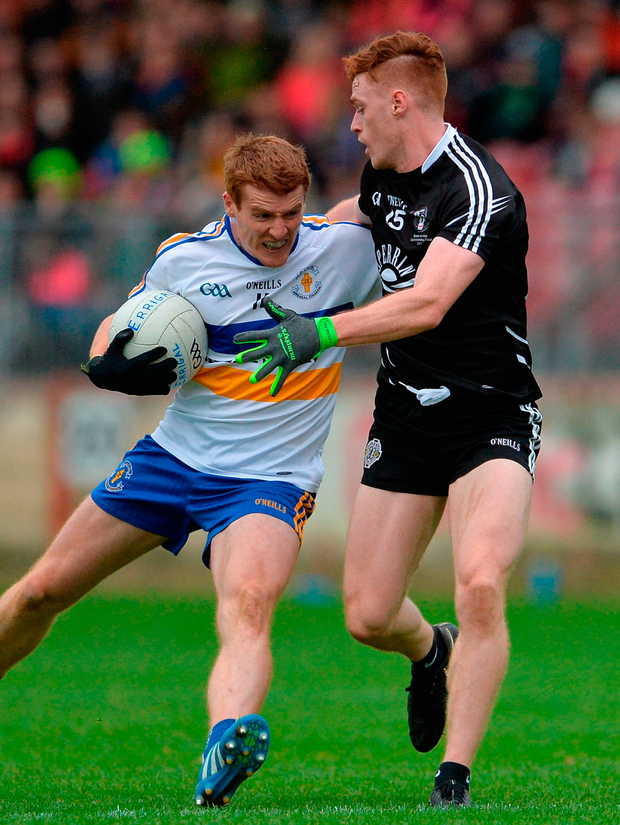 Peter Harte of Errigal Ciaran battle with Conor Meyler of Omagh St Enda's. Photo: Oliver McVeigh/Sportsfile