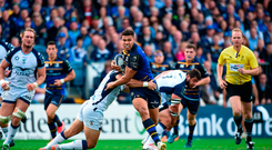 Adam Byrne of Leinster is tackled by Thomas Darmon of Montpellier