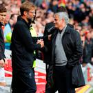 Liverpool manager Jurgen Klopp with Jose Mourinho