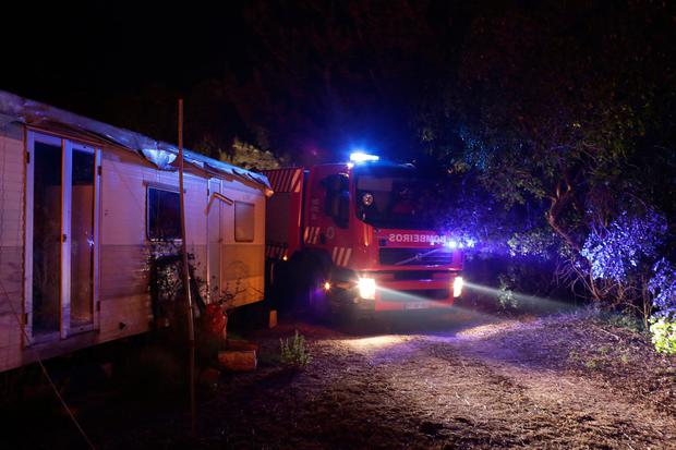 A fire engine maneuvers to get through to the backyard of a house as a wildfire approached houses in the outskirts of Obidos, Portugal, in the early hours of Monday, Oct. 16 2017. (AP Photo/Armando Franca)