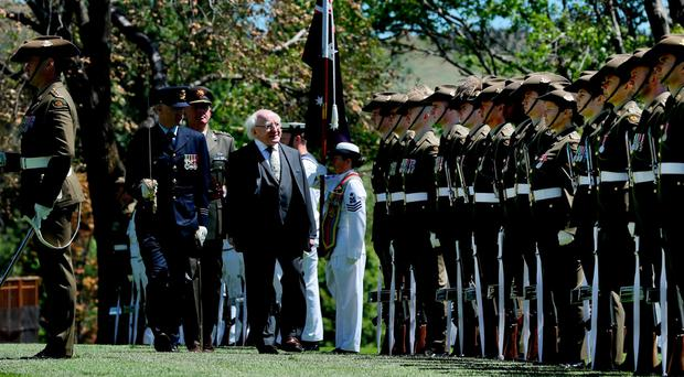 President Michael D Higgins inspects a guard of honour on the second day of his visit to Canberra. Photo: Maxwells