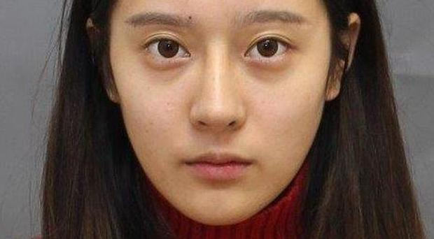 Jingyi 'Kitty' Wang allegedly ran an unlicensed surgical clinic from the basement of her house Toronto Police