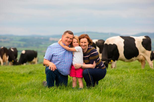 Virtual vet developer Sinead Quealy, her husband Patrick and their daughter Jo on the family farm in Kilmacthomas, Co Waterford