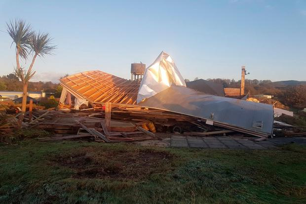 A mobile home is destroyed after high waves breached the coastal protection defence during storm Ophelia at the caravan in Arklow, Co.Wicklow
