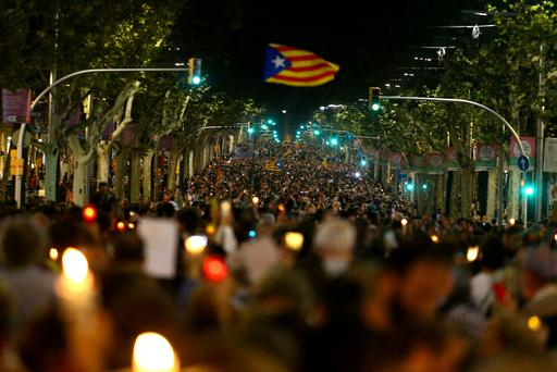 People wave Esteladas (Catalan separatist flag) during a gathering to protest against the imprisonment of leaders of two of the largest Catalan separatist organizations, Catalan National Assembly's Jordi Sanchez and Omnium's Jordi Cuixart, who were jailed by Spain's High Court, in Barcelona, Spain October 17, 2017. REUTERS/Ivan Alvarado